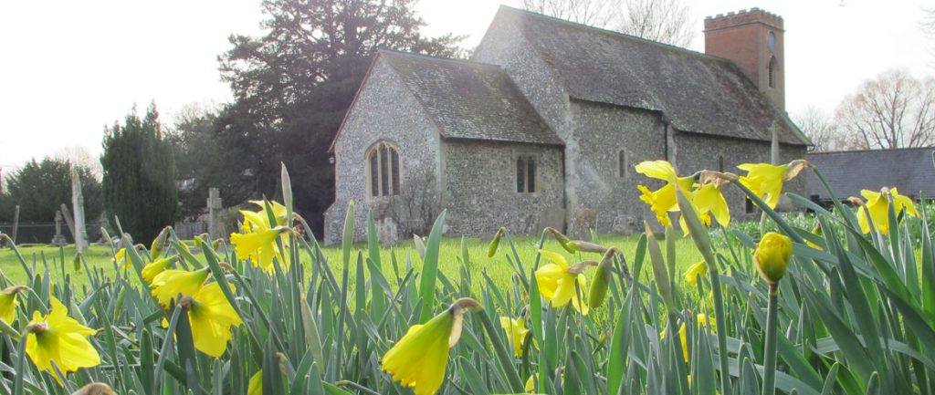 The church in Frilsham with daffodils