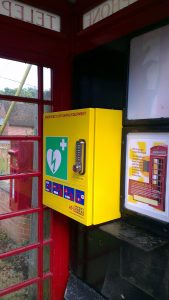 An image of the yellow defibrillator in the red phone box in Frilsham